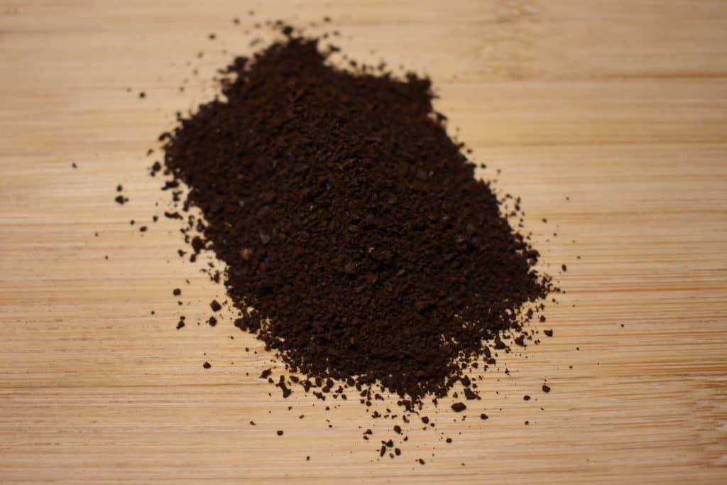 Ground coffee beans to display proper grind for this technique