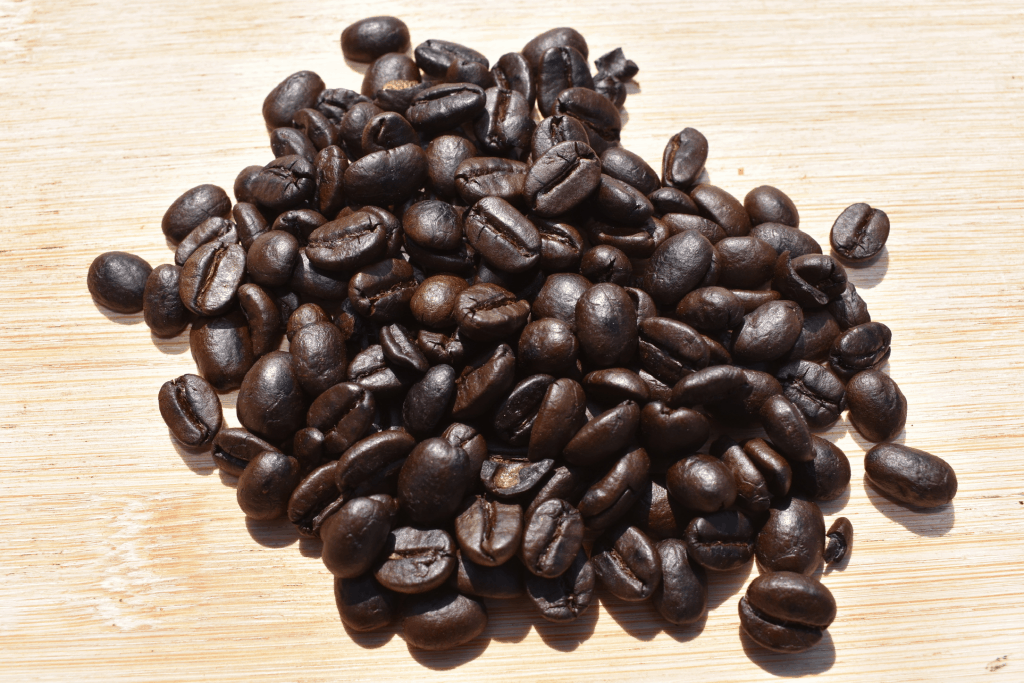 Dark roasted coffee beans are showcased here.