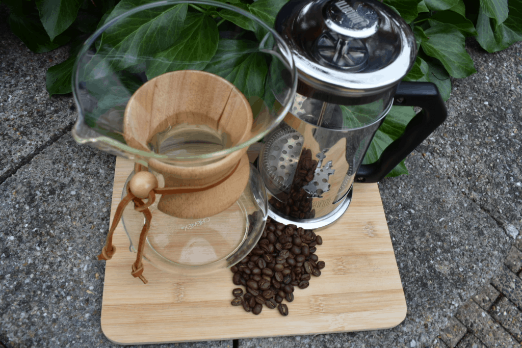 Chemex and french press next to each other with coffee beans in front