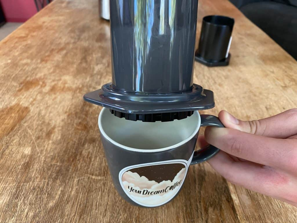 AeroPress upside down onto a cup, ready for extraction
