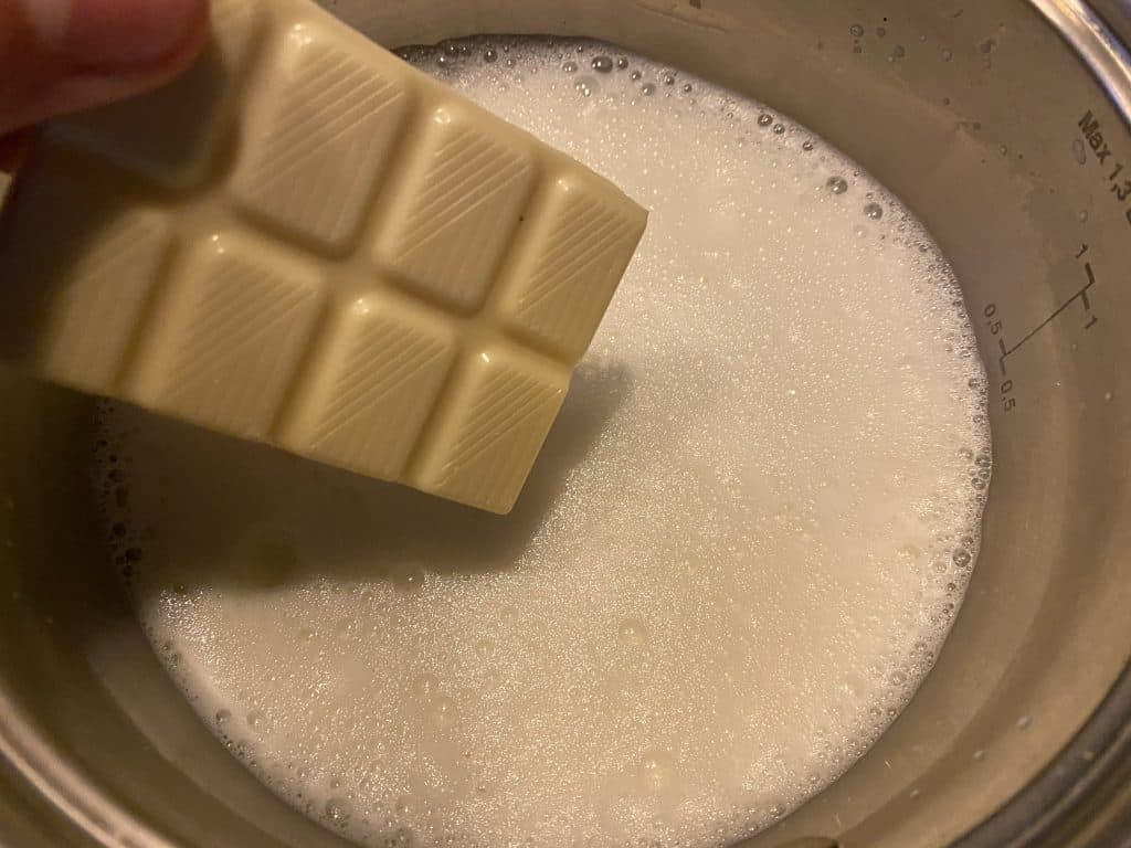 Chocolate being added to the warm milk
