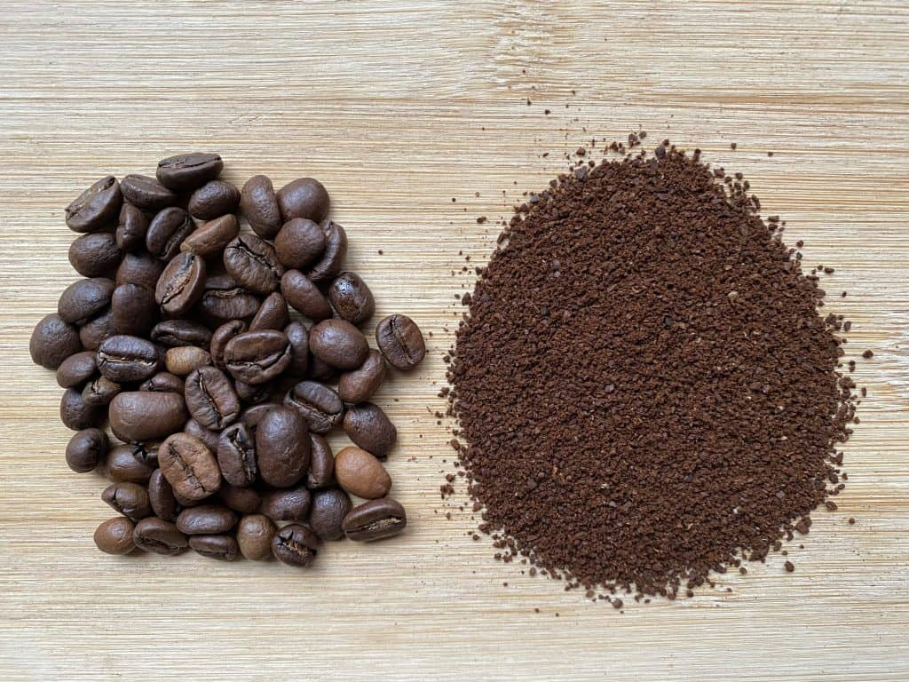 """""""Costa Rican coffee beans next to the ground version of it"""""""