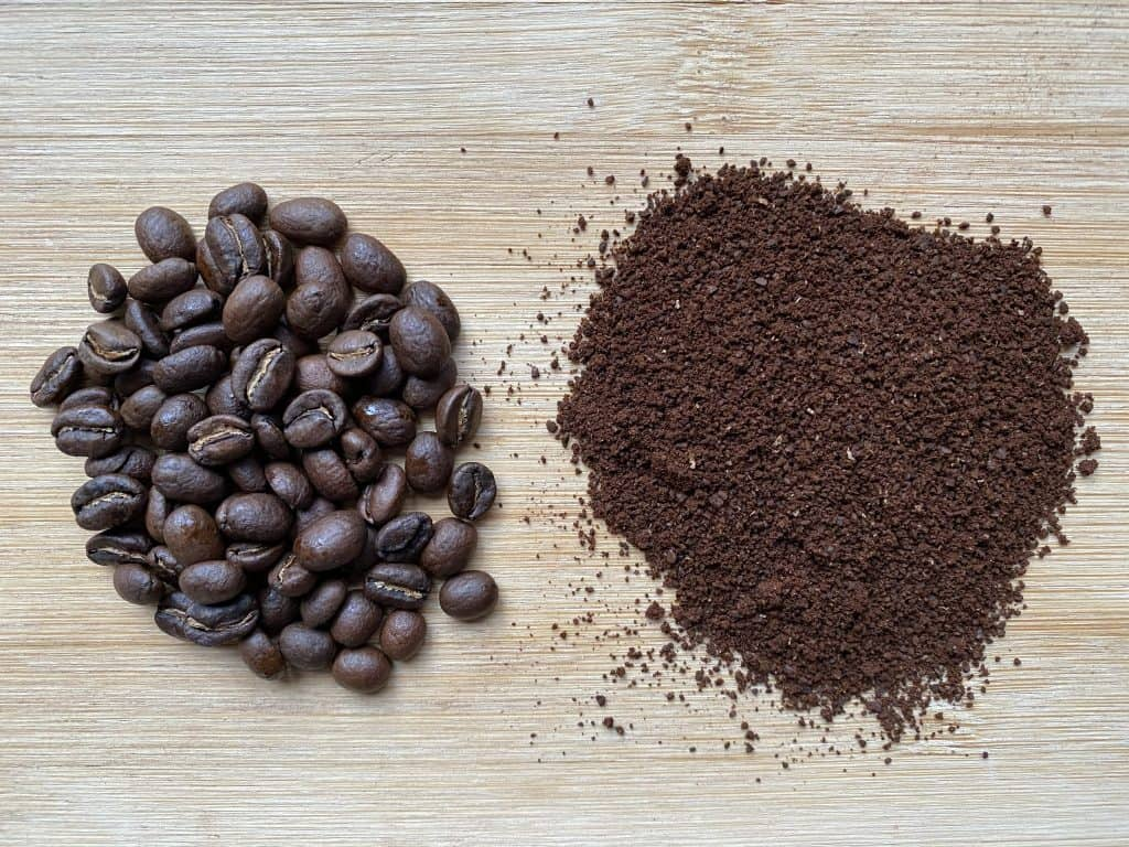 """""""Ethiopian coffee beans next to the ground version of it"""""""