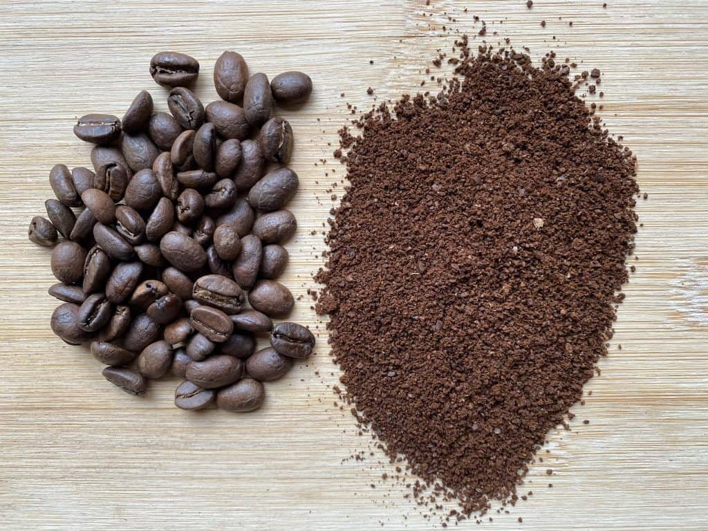 """""""Peruvian coffee beans next to the ground version of it"""""""