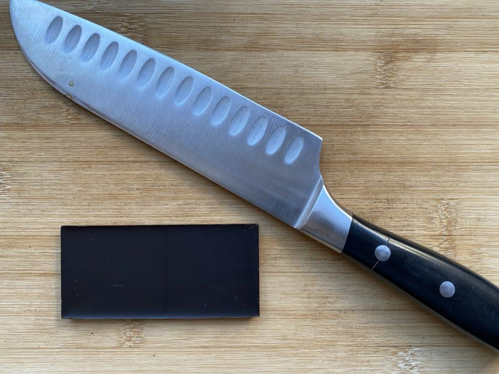 """""""Chef's knife and chocolate on a cutting board"""""""