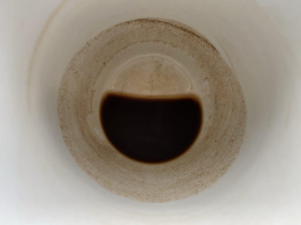 """Coffee sludge in a cup"""