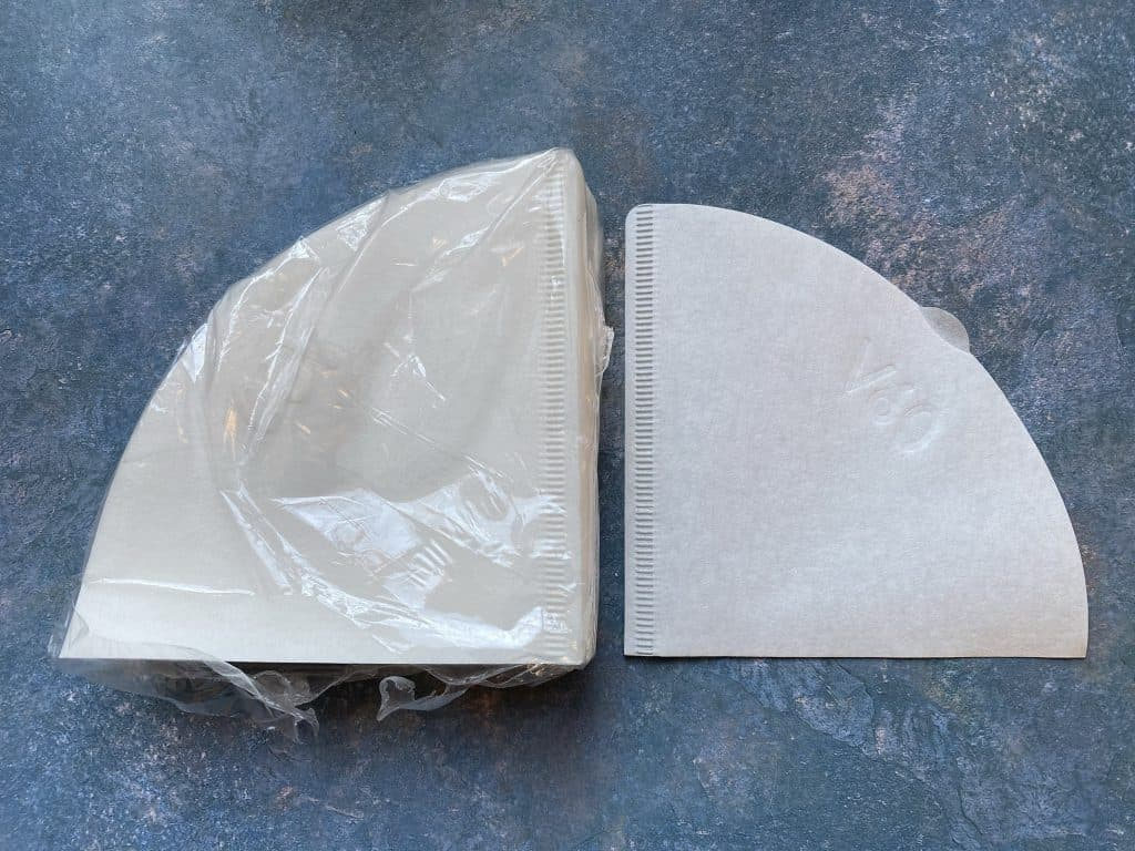 """""""Hario V60 coffee filter next to the packaging"""""""