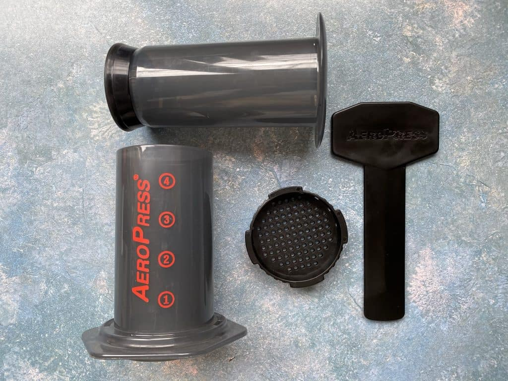"""""""AeroPress cylinders, filter cap, and stirring wand in one photo."""""""