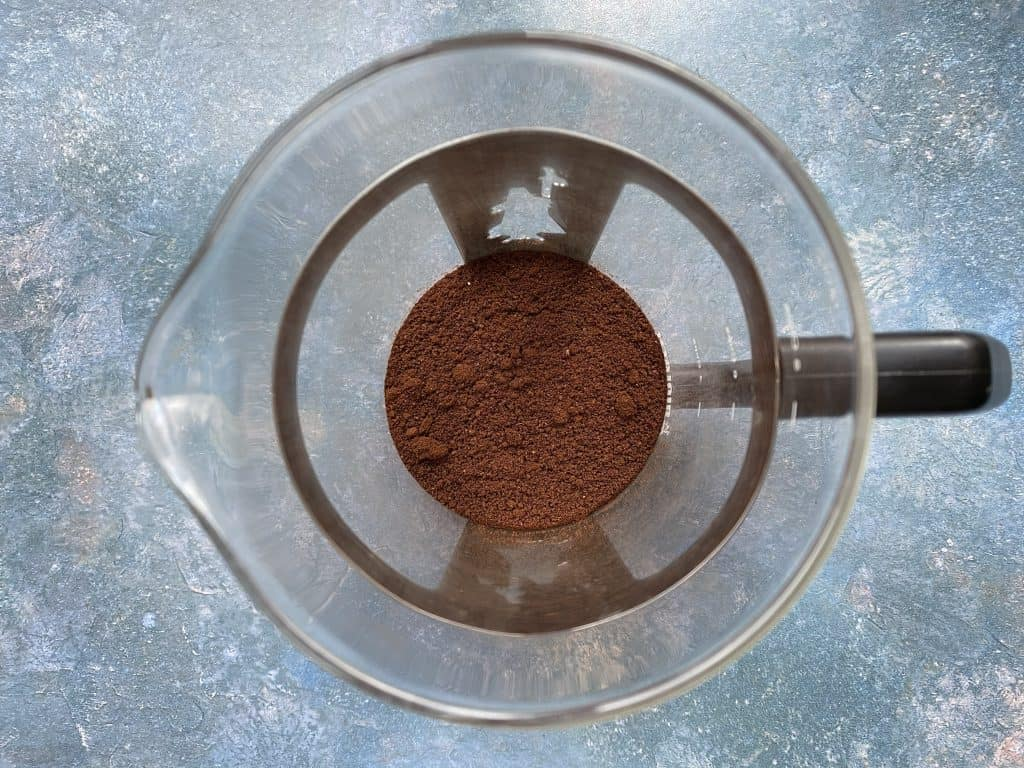 """""""Correct coffee grind size in the French press beaker before steeping with water."""""""