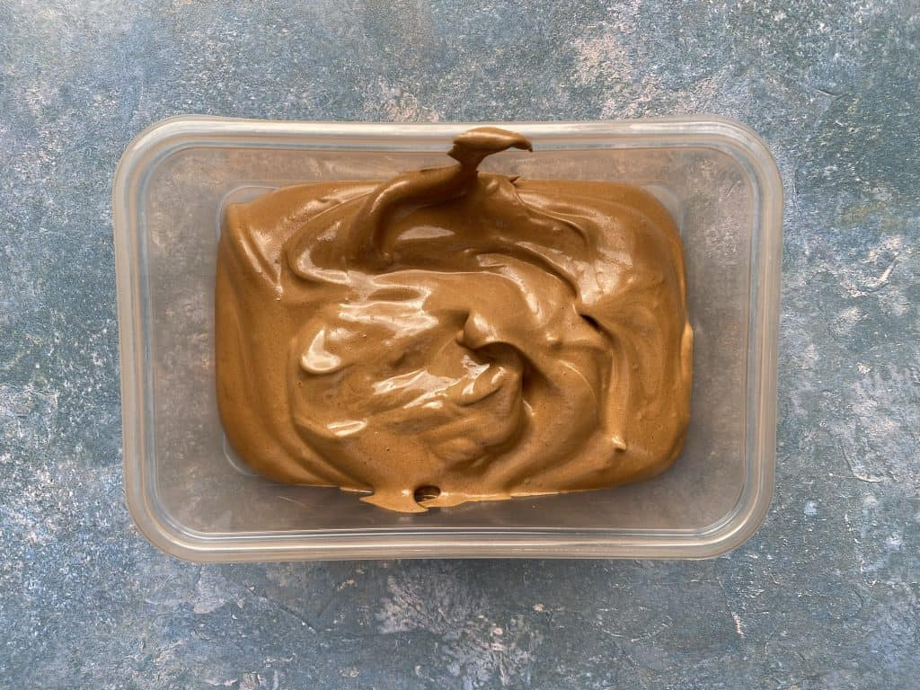 """""""Chocolate dalgona mousse stored in a container."""""""