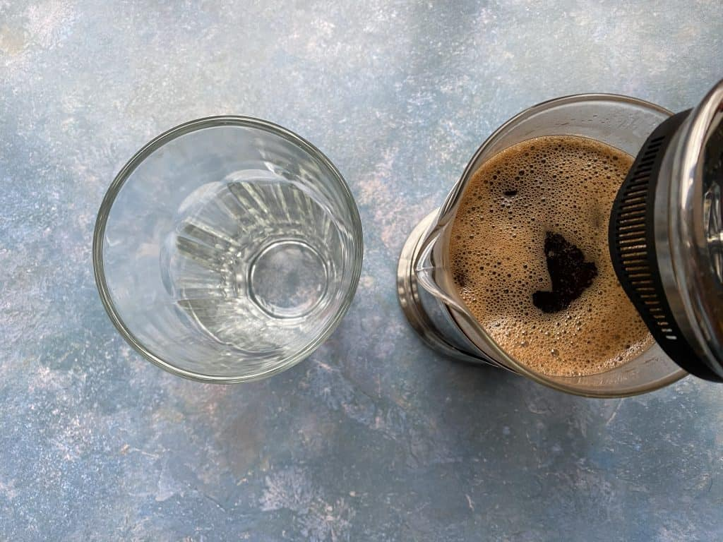 """""""Cold brew coffee just about to be filtered with a French press."""""""