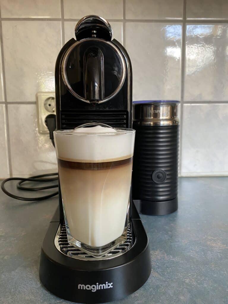 """Latte coffee under the Nespresso machine after the coffee has run through."""