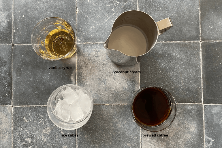 All ingredients needed to make a coconut iced coffee at home.