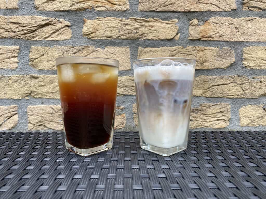 Iced Americano vs. iced latte next to each other for comparison.