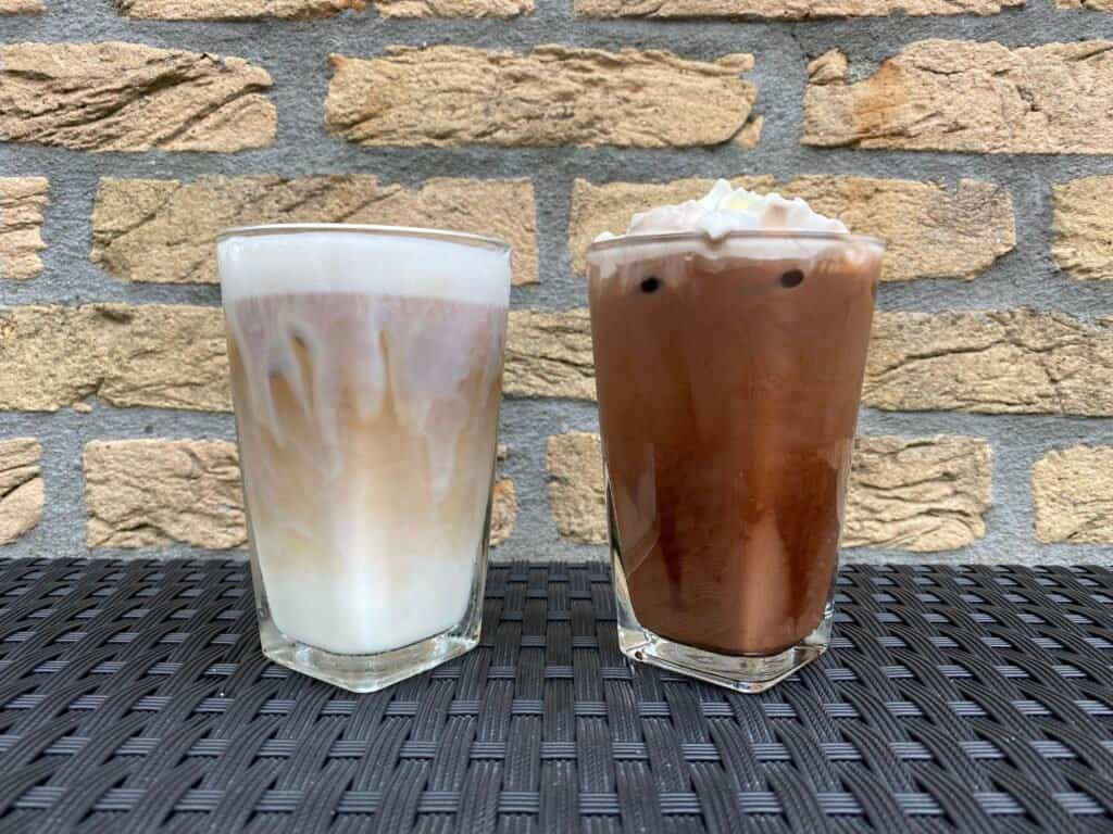 Iced latte vs. iced mocha compared next to each other.