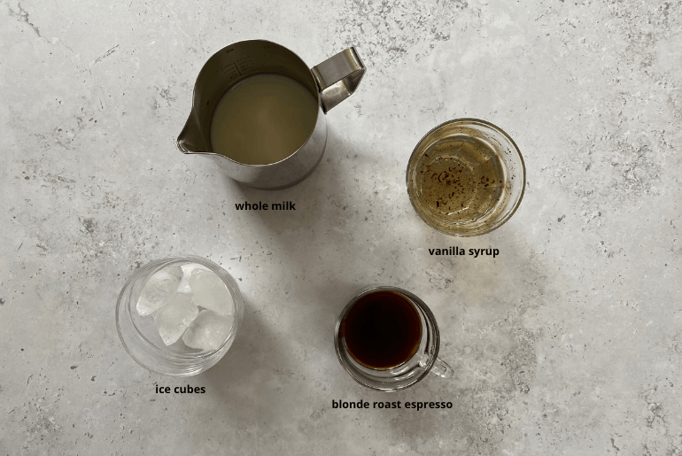 All ingredients that are used to make an iced blonde vanilla latte at home.