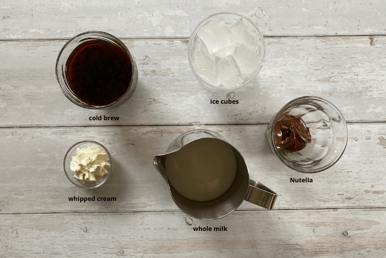 All ingredients used to make a Nutella cold brew coffee at home.