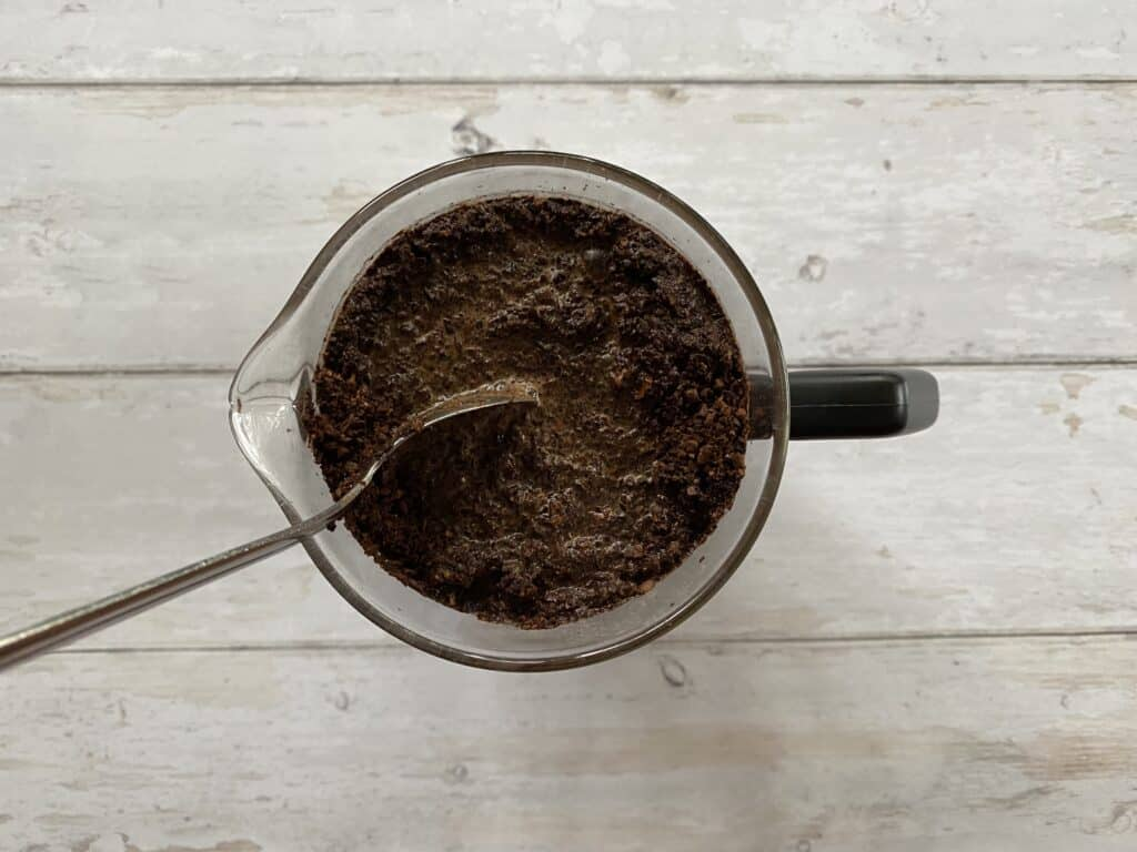 Stirring cold brew coffee in the French press beaker.