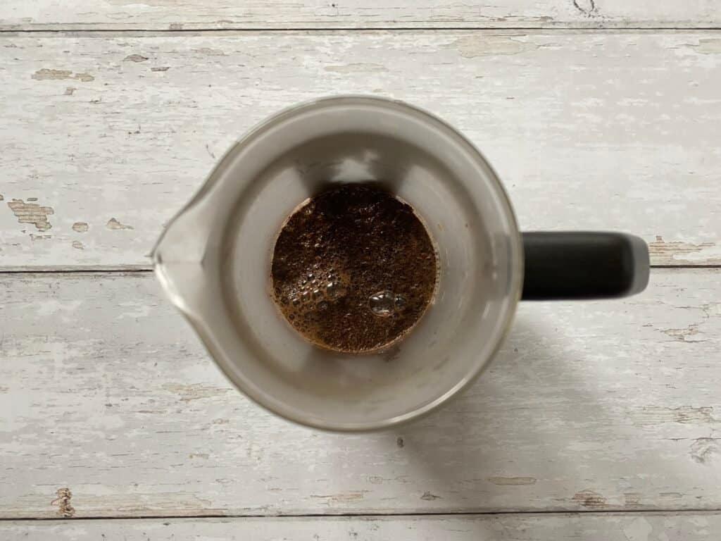 Brewing espresso in a French press.