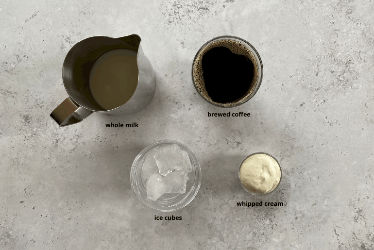 All ingredients used to make iced coffee with whipped cream at home.