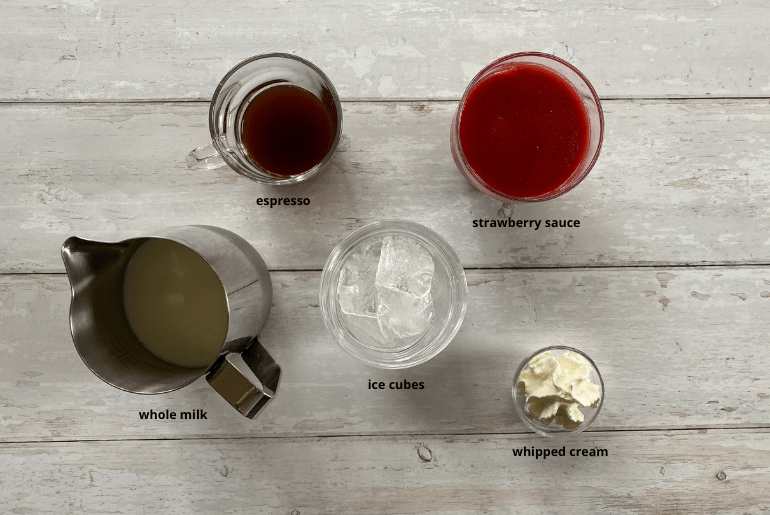 All ingredients needed to make an iced strawberry latte at home.