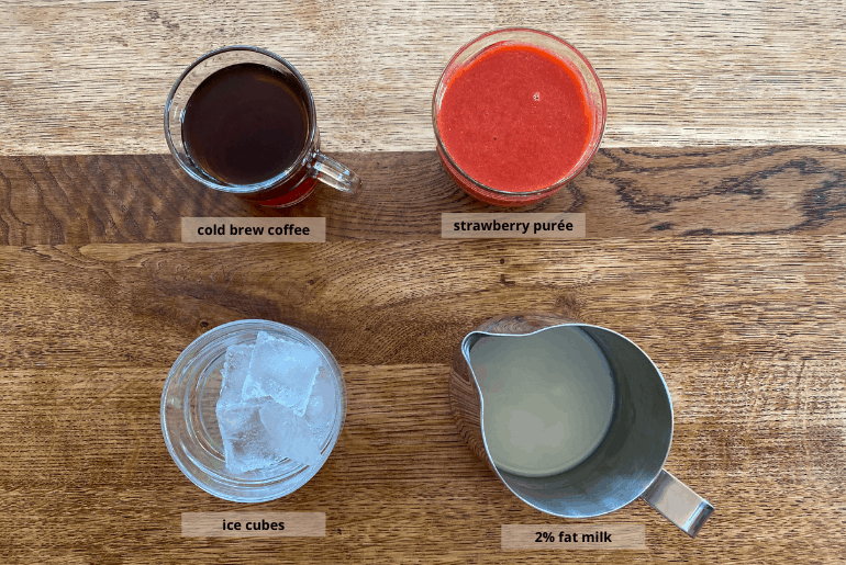 All ingredients used to make a strawberry cold brew coffee at home.