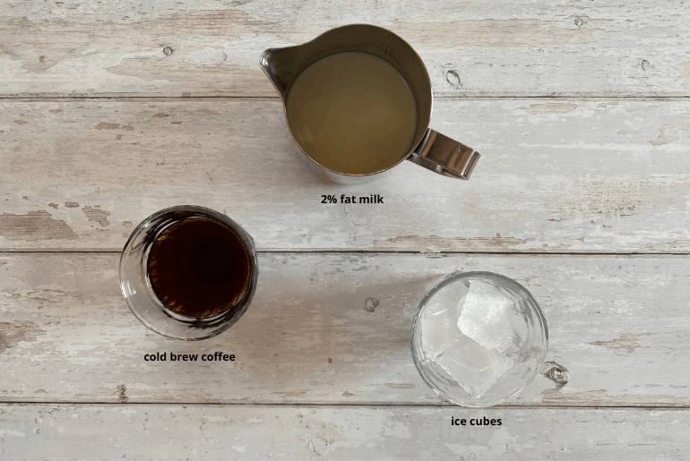All ingredients that are needed to make a cold brew latte at home.