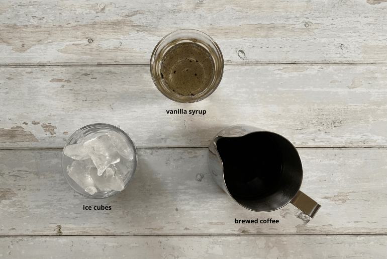 All ingredients that you need to make a vanilla iced coffee at home.