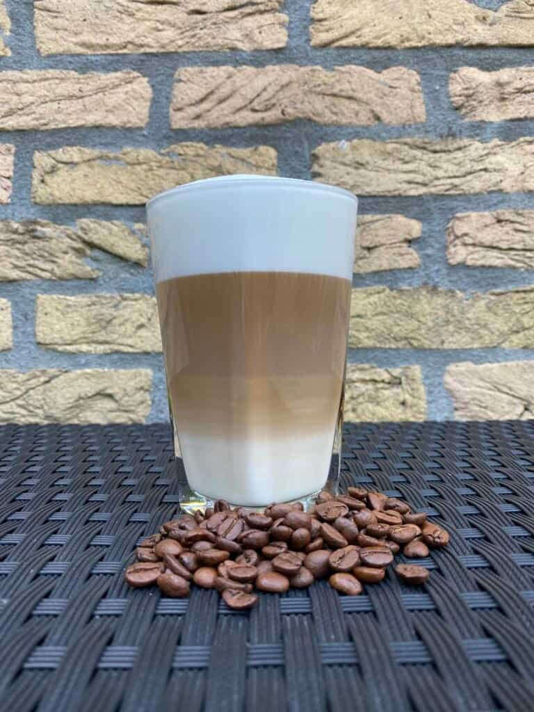 Homemade latte with coffee beans.