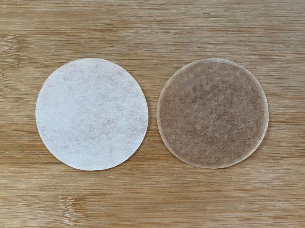 A comparison between a new AeroPress filter and one that has been used five times.