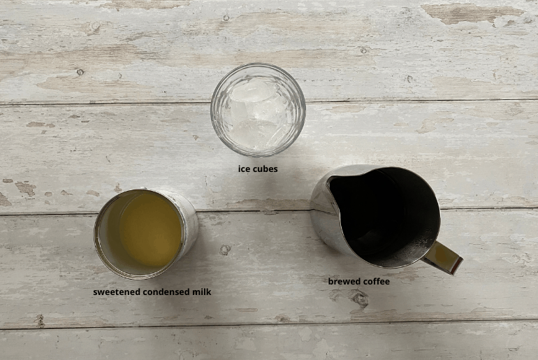 All ingredients that are used to make an iced coffee with condensed milk at home.