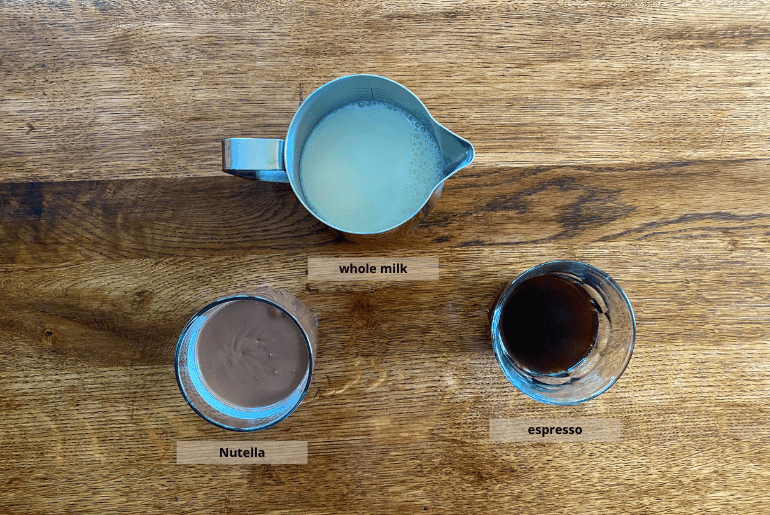 All ingredients that are used to make a Nutella latte at home.